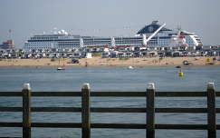 IJMUIDEN-NEDERLAND, View from the pier to the beach and Cruise-ship MSC Opera
